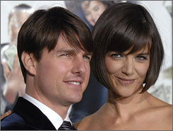 In the spotlight: Andrew Morton's  Tom Cruise: An Unauthorized Biography,  which hits stores Tuesday, claims that  Cruise's wife, Katie Holmes, has  misgivings about her marriage to  the superstar.