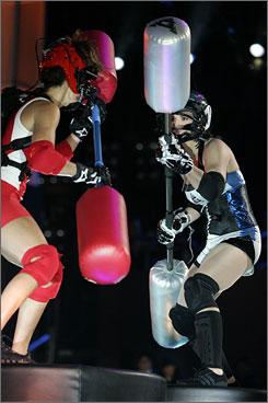 Surprise hit: Christie, left, and Crush battle on NBC's American Gladiators.