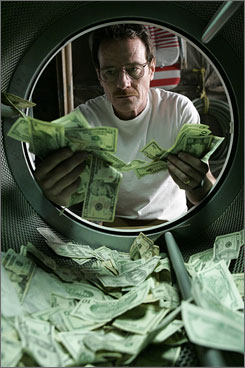 Desperate move: Terminally ill Walter White (Bryan Cranston) launders  money  literally  and makes crystal meth to provide for his family.