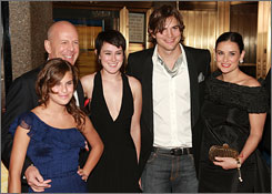 At Live Free premiere: Bruce Willis, left, with Tallulah Belle and Rumer, his children with Demi Moore, right, and Moore's current husband, Ashton Kutcher.