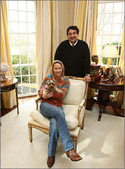 Puppy's (and owners') paradise: Leonsis and his wife, Lynn, give their dog, Coco, free rein in the 22,000-square-foot home.