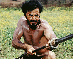 The running man: Cornel Wilde flees African tribesmen.