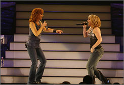 Girl power: Reba McEntire, left, and Kelly Clarkson open their show at Wright State University in Dayton, Ohio, with the Eurythmics' Sweet Dreams.