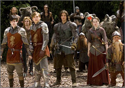 In for a battle: It's 1,300 years later, and Prince Caspian (Ben Barnes, center) must call upon Edmund  (Keynes, foreground left), Peter (Moseley) and Susan (Popplewell) as well as red dwarf Trumpkin  (Peter Dinklage, far right) to help battle the pirate-like Telmarines and reclaim the kingdom of Narnia.