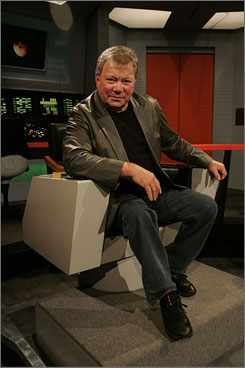 An old friend: Shatner in Kirk's chair in Long Beach, Calif.