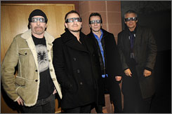 U2 can see: The Edge, left, Bono, Larry Mullen Jr. and Adam Clayton model viewing glasses before the screening of U2 3D near Park City, Utah. The band's concert movie opens in select theaters nationally on Wednesday
