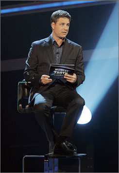 Twist on 21 questions: Host Mark L. Walberg  presides as contestants answer questions  based on off-camera responses they  had given while strapped to a lie detector.