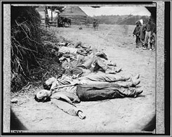 The bodies of Confederate soldiers are collected for burial in May 1864 near Spotsylvania Court House, Va. Gruesome Civil War scenes such as this traumatized our young nation, according to Drew Gilpin Faust's This Republic of Suffering.