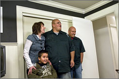 Wow!: Paige Davis shows homeowner Sergio Alvarado, his 5-year-old  son, Sam, and Alvarado's brother Rudy Alvarado what $1,000 can do.