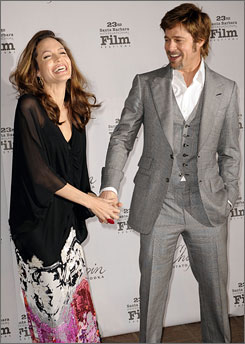 Angelina Jolie and Brad Pitt share a laugh on their way to the Santa Barbara International Film Festival Saturday.