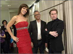 In good hands: Ana Ortiz gets fitted by Mark Badgley, center, and James Mischka for The Heart Truth Red Dress Collection fashion show