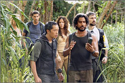 The story continues: Lost, with Matthew Fox, left, Ken Leung, Evangeline Lilly, Naveen Andrews and Jeremy Davies, plans to make five more episodes.