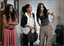Golden Brooks,left, Tracee Ellis Ross and Persia White star as best friends on the CW series Girlfriends.