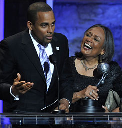 CSI: NY's Hill Harper is flanked by his mom as he accepts his best dramatic TV actor award.  He spent the strike on the stump for longtime pal and Harvard Law school classmate Barack Obama.