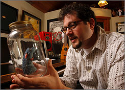 Bottling success: Michael Giacchino could be adding the Oscar statuette to his collection of memorabilia from Ratatouille, Lost and other endeavors.