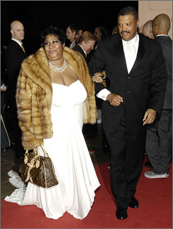 Aretha Franklin steps out in a fur at a Grammys after-party.