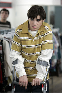Babe magnet: RJ Mitte, who doesn't use crutches, had to learn how to walk with them to play Walter Jr.