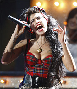 Winehouse: 368% increase for  Black; 234% for Rehab downloads.