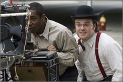 "We're rolling!: Mos Def, left, works at a movie store, but when Jack Black's movie lover with a ""magnetic"" personality erases the videos, the friends decide to remake the films."