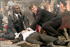 From their perspective: Richard T. Jones, left, Dennis Quaid and the downed president (William Hurt).
