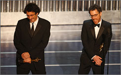 Joel, left, and Ethan Coen shared in No Country's wins for adapted screenplay and director. The film also won the top award of the night, best picture.