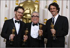 Last year's best-director winner, Martin Scorsese, helps Ethan Coen and Joel Coen carry their four trophies.