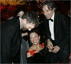 Best-actor winner Daniel Day-Lewis, right, celebrates with his There Will Be Blood director, Paul Thomas Anderson, and wife Rebecca Miller.