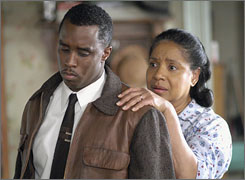 Striving and struggling: Sean Combs plays Walter Younger and Phylicia Rashad is Lena Younger in ABC's adaptation of Lorraine Hansberry's drama A Raisin in the Sun. Sanaa Lathan and Audra McDonald also star.