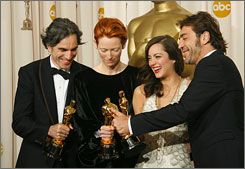 And the winners are... from all over : Best actor Daniel Day-Lewis, Britain/Ireland; best supporting actress Tilda Swinton, Britain; best actress Marion Cotillard, France; best supporting actor Javier Bardem, Spain.