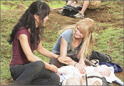 Back to the island: Sun (Yunjin Kim), left, Claire (Emilie de Ravin) and baby Aaron on Lost.