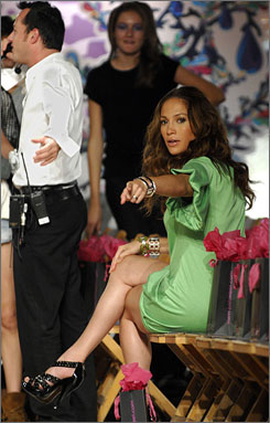Sweet side gig: Jennifer Lopez gets everyting just right at the Fashion Week show for her line justsweet last fall.
