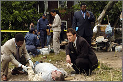 A bloody end: Clarke Peters, left, and Dominic West are the detectives on The Wire's last case. The finale of the HBO series, which has enjoyed critical acclaim but not-so-stellar ratings, airs Sunday.