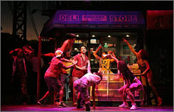 In the Heights is set in New York's Washington Heights neighborhood. Lin-Manuel Miranda, center, wrote the music and lyrics and also stars as Usnavi, an unlikely tribute to his adopted country.
