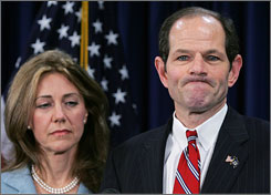 An apology: The governor says sorry with wife Silda Wall Spitzer at his side.