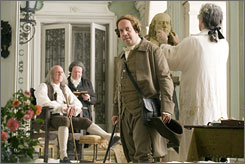 Seven-part miniseries: Paul Giamatti, front, with Tom Wilkinson, left, and Sean McKenzie, is the nation's second president.