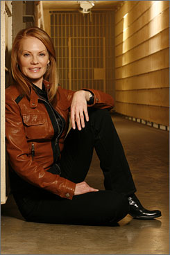 You can't contain her: Marg Helgenberger takes a break from shooting CSI at the Sybil Brand  Women's Prison in Monterey Park, Calif. Helgenberger, 49, is glad to be back to work on the show.