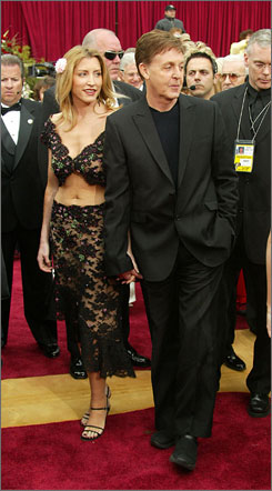 In happier times: Heather Mills and Paul McCartney attend the Academy Awards in 2002, just a few months before they marry.