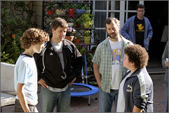 Letting their guard down: Nate Hartley, left, director Steven Brill, producer Judd Apatow and Troy Gentile work out a scene for Drillbit Taylor.