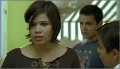 Carlitos' way: Carlitos (Adrian Alonso, right) is trying to reach his  mom. America Ferrera is a smuggler. In background: Jesse Garcia.