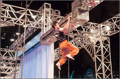 Hang tough: Toshihiro Takeda competes in Japanese tournament Ninja  Warrior. Cable channel G4's top show will feature two Americans in May.