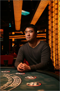 Hit me!: Jeff Ma and five fellow MIT students counted cards at Vegas blackjack tables, like this one at the Planet Hollywood Resort and Casino, winning millions and providing a basis for the new film 21. It opens Friday.