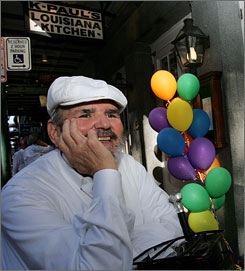 Celebrated Cajun cook Paul Prudhomme was nicked by a bullet on the arm while catering a golf tournament Tuesday in New Orleans.