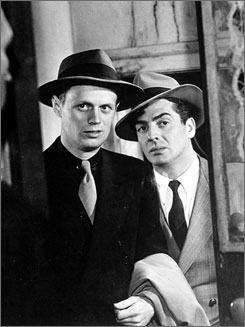 Richard Widmark, who rose to fame after playing a killer with a silly side in Kiss of Death, died Monday at his home in Roxbury, Conn., after a long illness. He was 93. Here, Widmark, left, with Victor Mature in a scene from Kiss of Death.