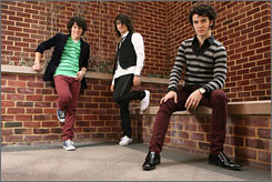 "Stars in  stripes:  Nick Jonas, 15,  left, Joe, 18, and  Kevin, 20, are  not a ""manufactured""  band."