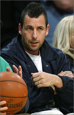 Adam Sandler, seen on the sidelines of a Los Angeles Lakers game last fall, will be stuck there for a while  he broke his ankle playing hoops over the weekend. But at least he won the game before he went down in agony.