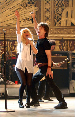 Allow me to introduce myself: Christina Aguilera and Mick Jagger perform Live With  Me at the Beacon Theatre in New York for Shine a Light. Keith Richards had no idea who she was.