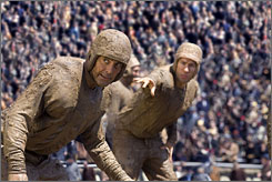 Hut-hut: George Clooney, left, and John Krasinski are 1920s football stars vying for Renee Zellweger's affection.