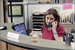 Back to work: Jenna Fischer, who plays Pam the receptionist, is enthusiastic about the six new episodes of The Office.