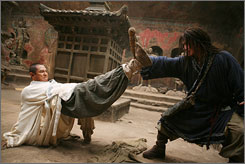 Martial arts legends Jet Li and Jackie Chan star in Forbidden Kingdom.