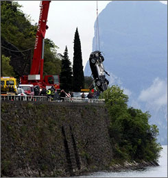 Oops: The Aston Martin being used in Quantum of Solace careened off the road and into a lake on the way to the northern Italian set.